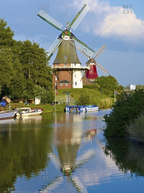 January 10, 2013: Twin windmills at the Siel in Greetsiel, East Frisia, Lower Saxony, Germany