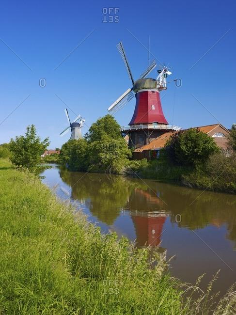 Twin windmills at the Siel in Greetsiel, East Frisia, Lower Saxony, Germany