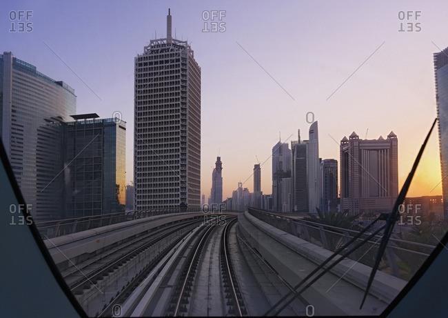 Metro next to Sheikh Zayed Road at sunset, Dubai, United Arab Emirates