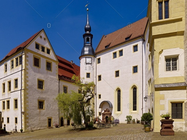 March 8, 2013: Rear courtyard with bell tower and palace chapel in Colditz, Saxony, Germany