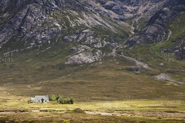 Lonely house in front of a mountain at Glencoe in the Scottish Highlands, Scotland, Great Britain