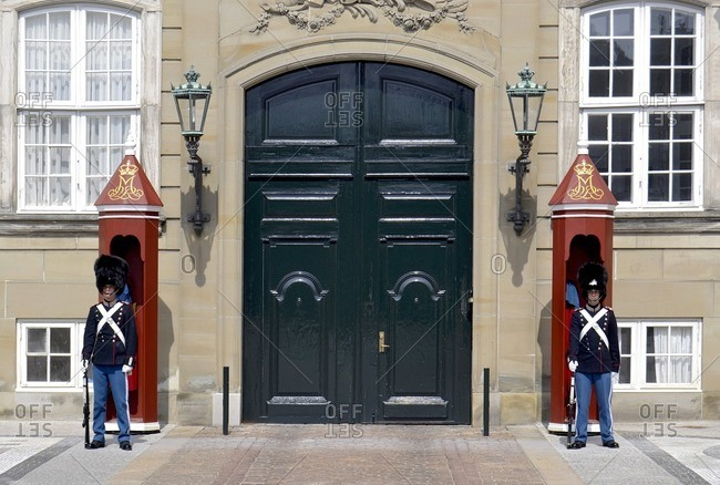 May 18, 2012: Guards in front of the entrance to Amalienborg Palace, Copenhagen, Denmark