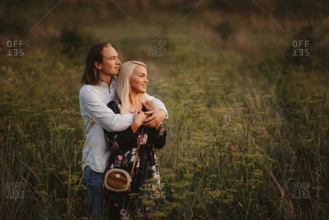 Man embracing woman in a field