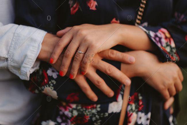 Close up of an engaged couple's hands