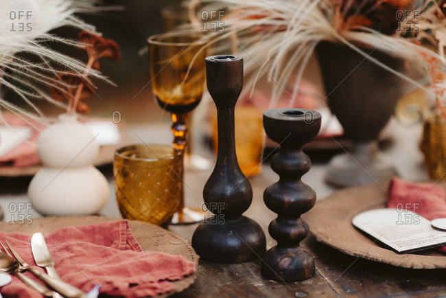 Close up of rustic table set with fall decorations outdoors