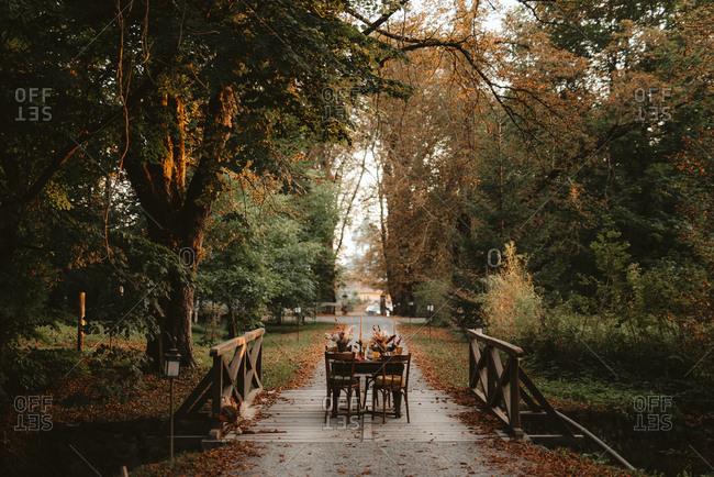 Rustic table set on a bridge
