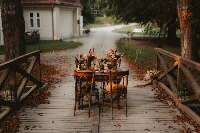 Rustic table set on a bridge in fall