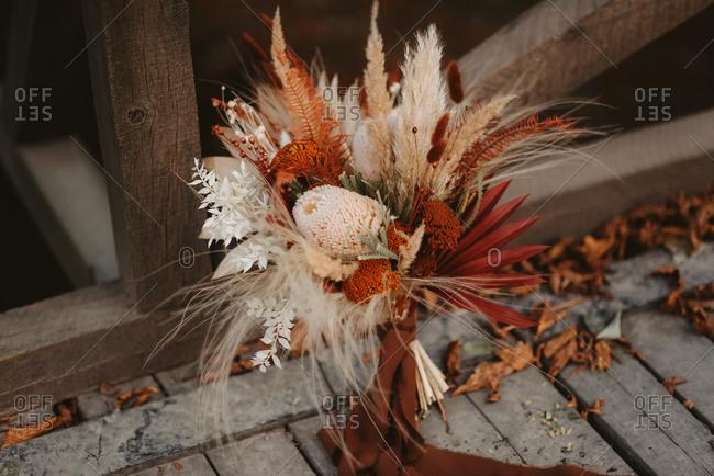 Autumnal bridal bouquet on a bridge