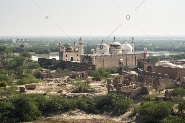 November 30, 2019: Abbasi Mosque, Cholistan Desert, Pakistan; 30 November 2019; Abbasi Mosque is located adjacent to the historical Derawar Fort and was built by the Nawab of Bahawalpur in 1844. The Mosque has one large hall and a big courtyard. It can accommodate up to 1000 people. Like Derawar Fort, the minarets of Abbasi Mosque are visible from a long distance while traveling through Cholistan Desert.