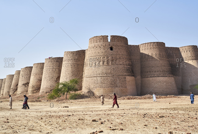 November 30, 2019: Derawar Fort, Cholistan Desert, Pakistan; November 2019; Derawar Fort is a large square fortress in Ahmadpur East Tehsil, Punjab, Pakistan. Derawar are visible for many miles in the Cholistan Desert. The walls have a perimeter of 1500 metres and stand up to thirty metres high. Derawar fort was first built in the 9th century AD by Rai Jajja Bhatti, a Hindu ruler of the Bhatti clan, as a tribute to Rawal Deoraj Bhati the king of Jaisalmer and Bahawalpur.