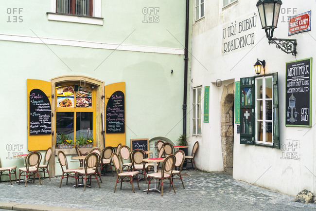 Prague, Czech Republic - May 9, 2017: Rustic cafe in old town of Prague in spring with painted walls