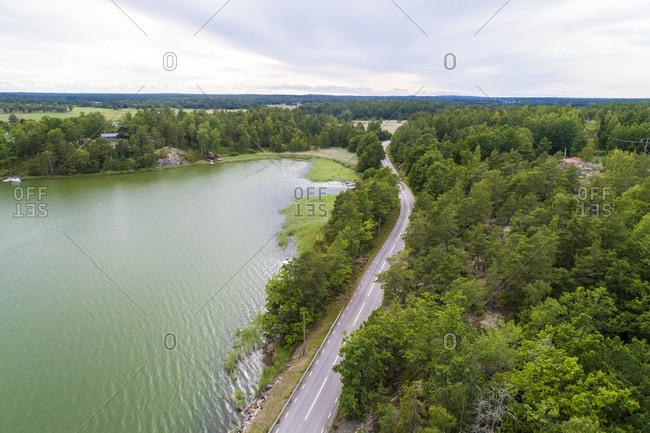 Aerial of a highway and lake in Loftahammar, Kalmar