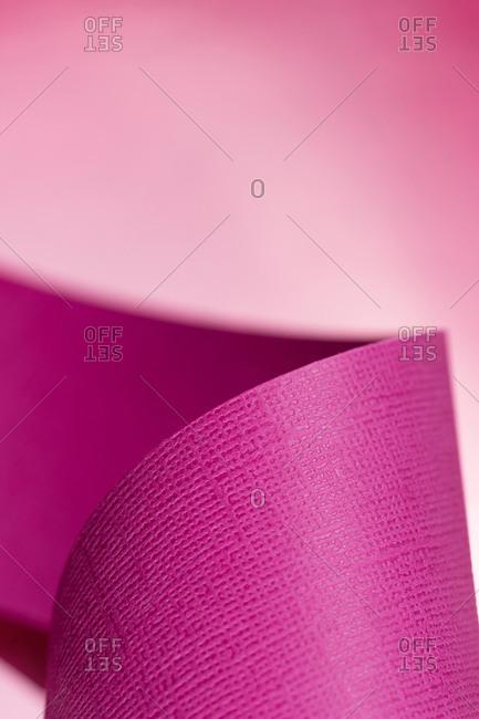 Pink paper design on color background