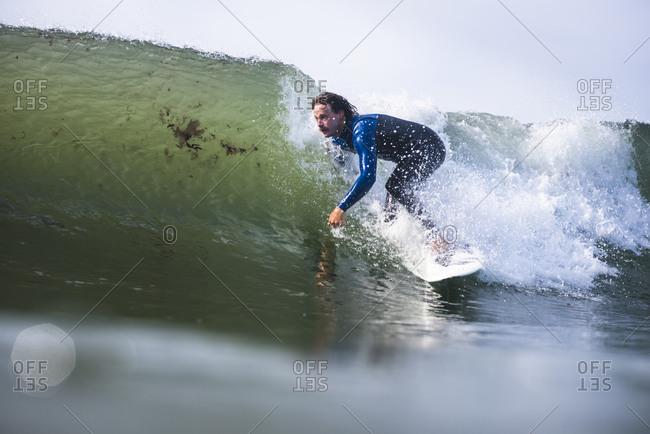 Man surfing in Rhode Island summer