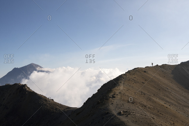 one person runs close to the summit of Iztaccihuatl volcano in Mexico