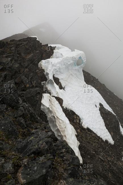 Snow below ridge on Cooper Mountain, Kenai Peninsula, Alaska