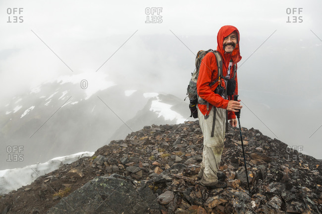 Man stands on summit of Cooper Mountain, Kenai Peninsula, Alaska