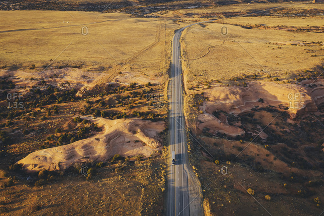 Lonely Utah's road in the evening with a truck from above