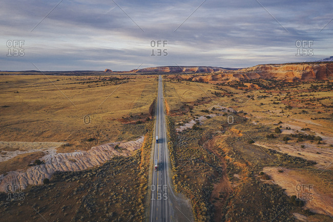 Lonely Utah's road in the evening with trucks from above