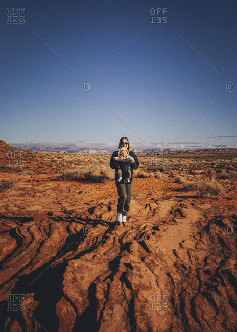 A woman with a child is standing near Horseshoe Bend, Arizona