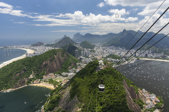 Beautiful view from Sugar Loaf cable car to green rainforest mountains
