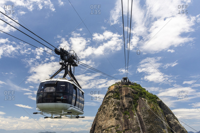 Rio de Janeiro, Brazil - January 6, 2020: Beautiful view from Sugar Loaf Mountain to cable car with blue sky