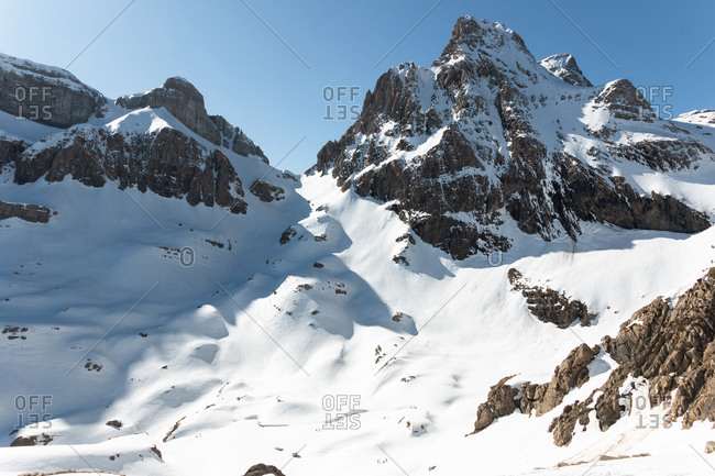 Panoramic view of snowy mountains in a sunny days of the Pyrenees
