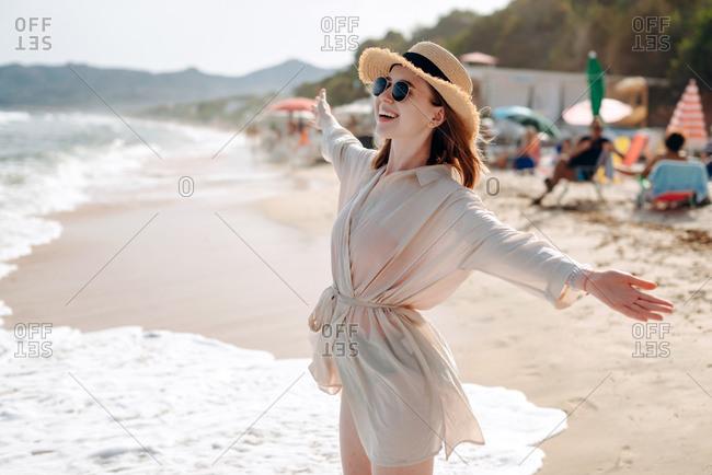 Beautiful, joyful girl by the sea, enjoying her vacation