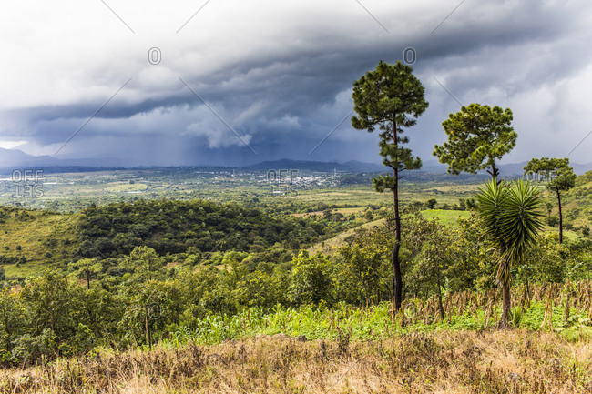 View of tropical storm in distance from a mountain in Guatemala.