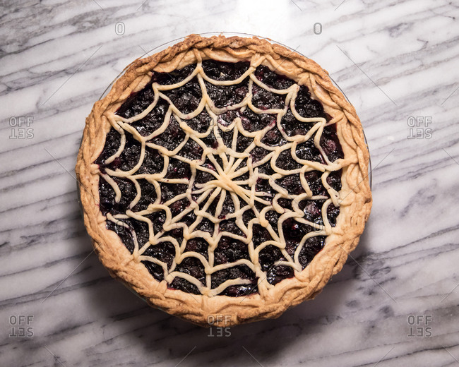 Blueberry Pie with Spiderweb Lattice Crust on Marble Pastry Board