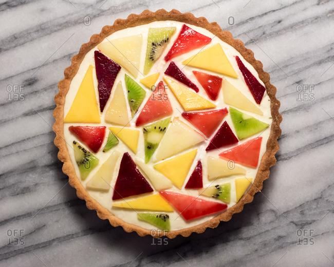 Abstract Fruit Tart with Mango, Kiwi, Plum, and Peach