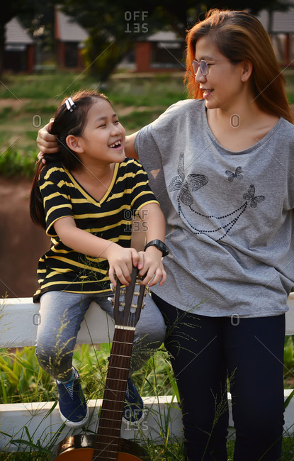 A happy moment of mother and daughter in public park