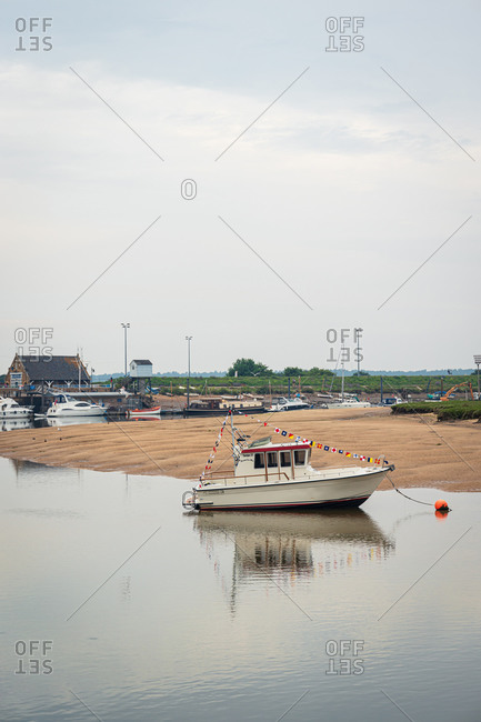 Wells-next-the-Sea, England, United Kingdom - June 24, 2018: A boat along the coast in Norfolk