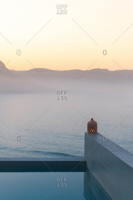 Sunrise over an infinity swimming pool