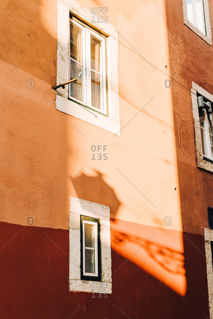Lights and shadows on the pink wall in Lisbon