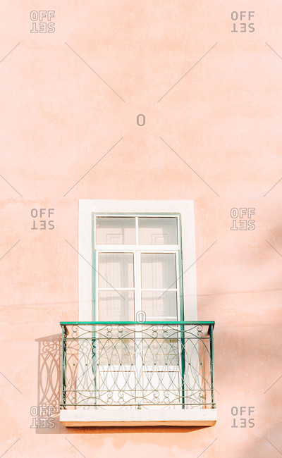 A wall and a window, pink, pastel tones, Lisbon, Portugal