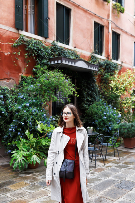 Young tourist in dress and coat on the streets of Venice