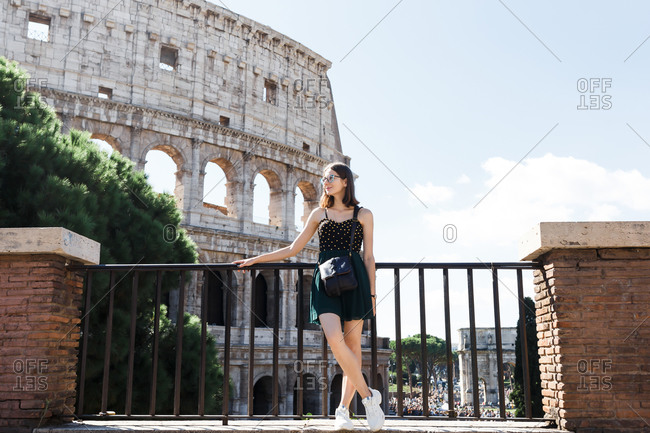 Young tourist walks the streets of Rome in summer