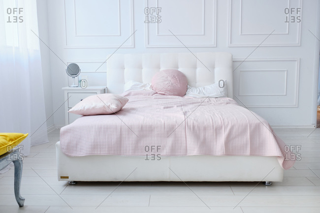 A large double bed in a bright room