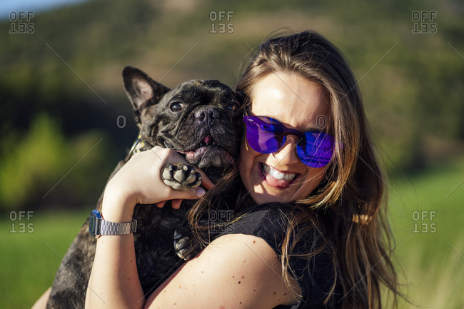Beautiful woman with her pet French bulldog