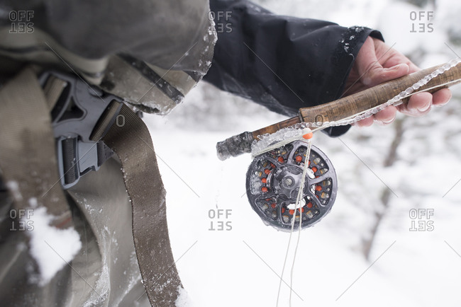A fly fisherman's rod covered in ice.