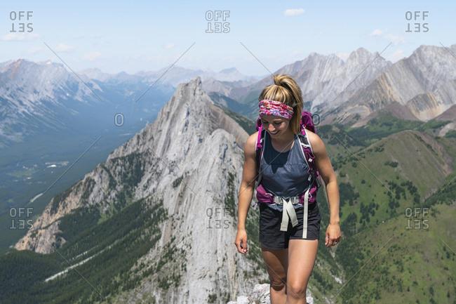 Female Hiking Along Rocky Ridge In Alberta's Kananaskis Country