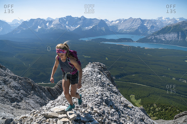 Female Hiker High Above Kananaskis Country In Alberta
