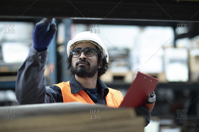 Young store worker controlling ware