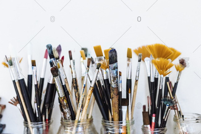 Composition of jars with various art brushes