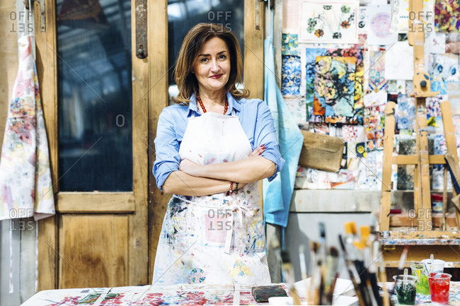Confident mature woman in own textile workshop