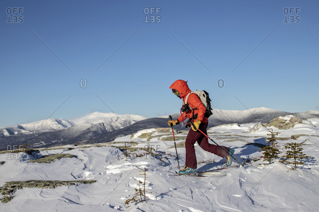 Backcountry skier skins across summit of Baldface, NH Mount Washington