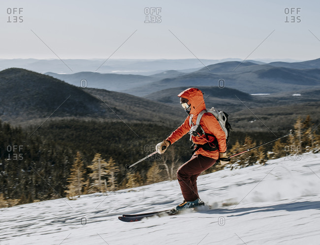 Skier speeds down slope on Baldface Mountain, New Hampshire