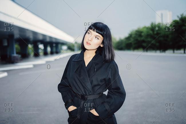 Beautiful young model in a black cloak