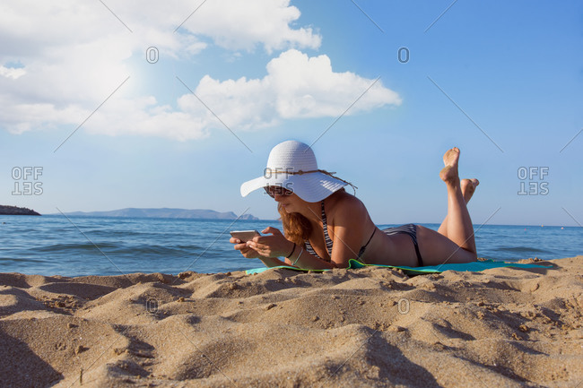 Woman enjoying summer vacation on the beach in Heraklion, Greece